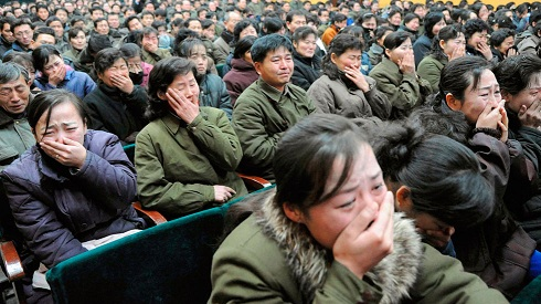 North Korean women crying