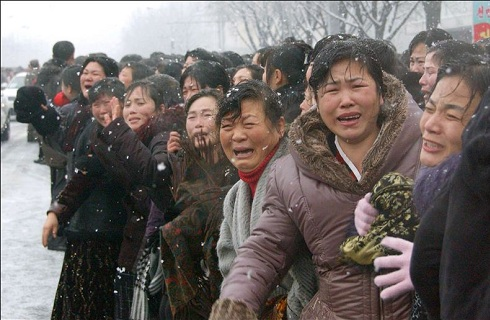 North Koreans mourning along the funeral procession of Kim Jong-il