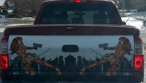 Sexy warrior women artwork on the tailgate of a truck