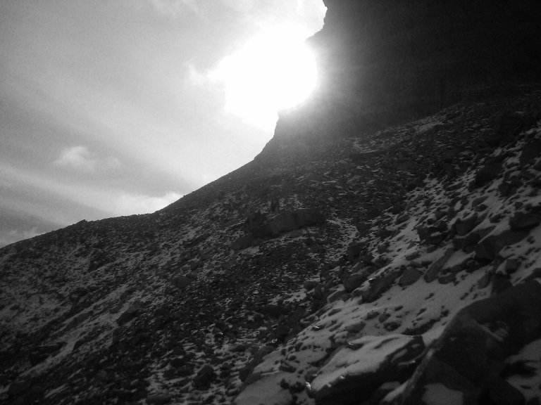Mountain Ridge with Sun in Black and White
