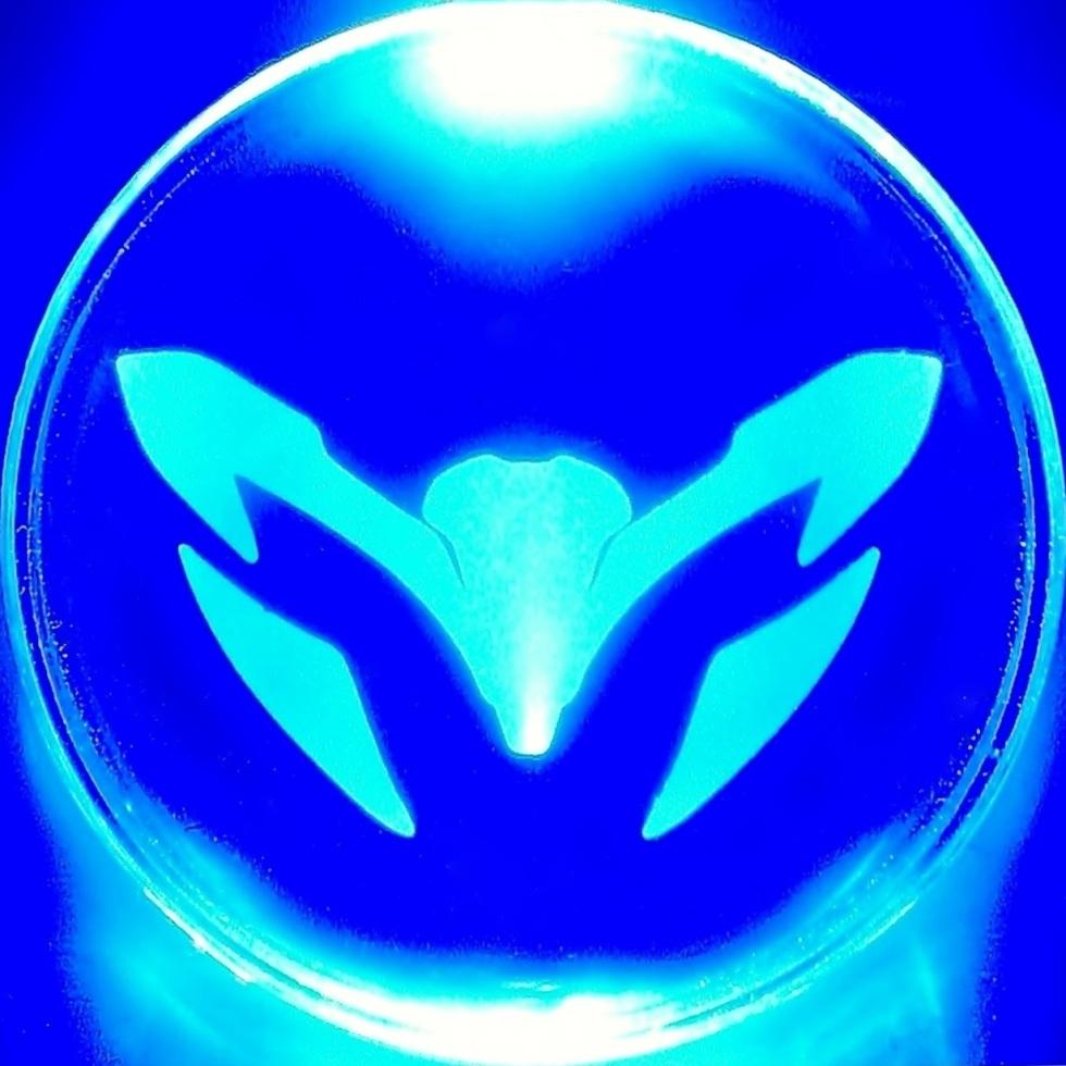 Max Steel emblem, lit in blue