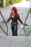 Black Widow cosplayer coming up stairs