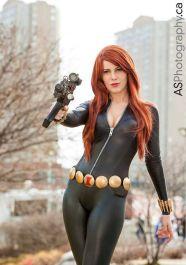 Black Widow cosplayer with a submachine gun
