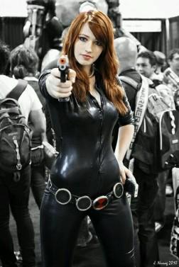 Black Widow cosplayer, aiming her gun