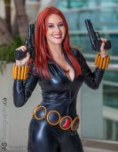 Black Widow cosplayer with guns drawn