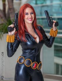 Black Widow cosplayer with guns drawn