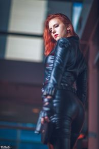 Black Widow cosplayer looking down