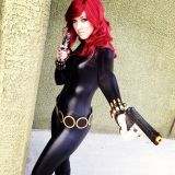 Black Widow cosplayer in black catsuit and low-slung belt