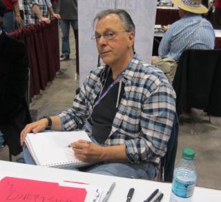 Howard Chaykin sketching at a comic book convention